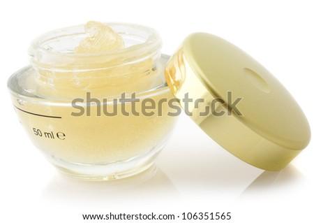 Opened jar of cosmetic cream isolated on white background. - stock photo