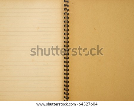 Opened last page of old yellowed spiral notebook - stock photo