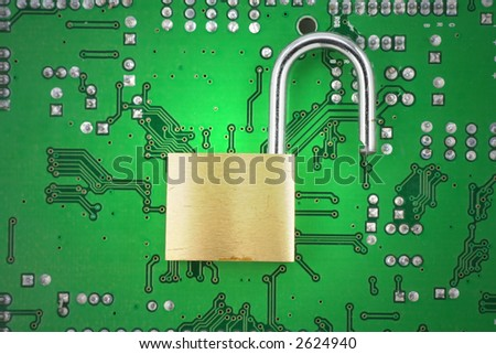 opened lock and circuit board, concept of computer safety - stock photo