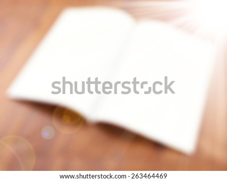 Opened magic book on the table,abstract blur background for web design,colorful, blurred,texture, wallpaper,illustration - stock photo
