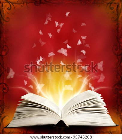 Opened magic book with magic light and butterfly. Education - stock photo
