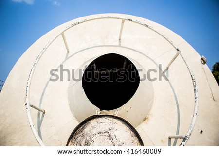 opened manhole on water tank
