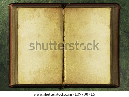 Opened old book background. Mysterious and magical. - stock photo