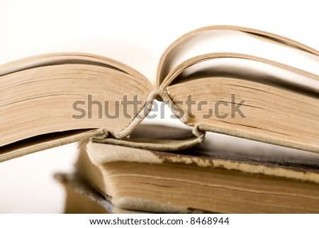 Opened old book. White background. Sepia tone. Shallow DOF. - stock photo