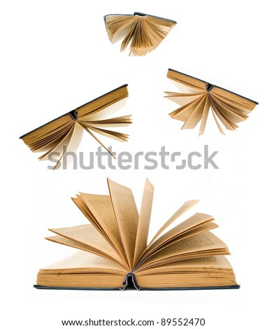 Opened old books fallen down (education concept) - stock photo