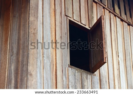 Opened old wooden window - stock photo