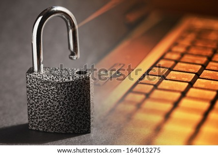 Opened padlock and computer keyboard. Security concept.  - stock photo