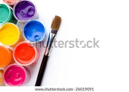 Opened paint buckets with brush - stock photo