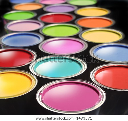 Opened paint buckets with various colors - stock photo