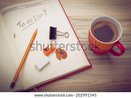 Opened personal organizer with a to do list - stock photo