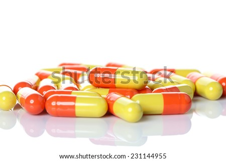 Opened pill with medicine powder