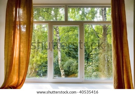 Opened plastic window in room with view to green trees - stock photo