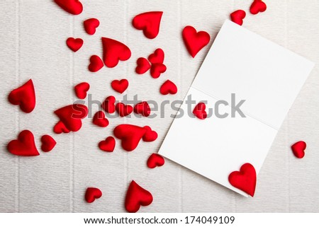 Opened postcard with a bunch of hearts around. Valentine Day des - stock photo