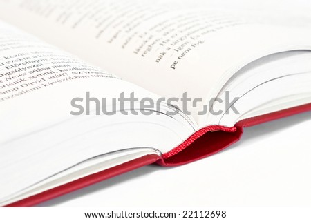 Opened red book white background. - stock photo