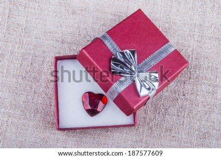 opened red gift box with jewel in form of heart - stock photo