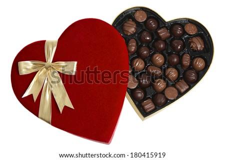 opened red heart shaped box of chocolates  - stock photo