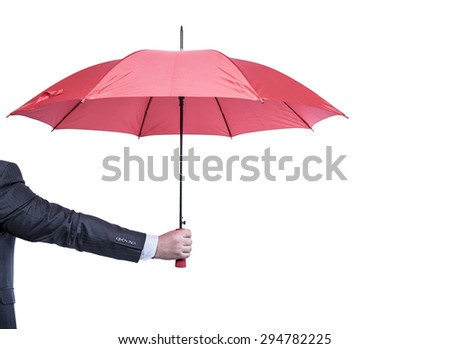 Opened red umbrella in hand, isolated on white.
