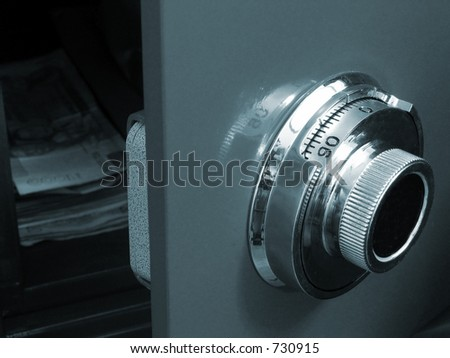 Opened safe (focus on the dial) - stock photo