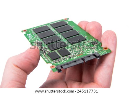 Opened solid state drive closeup on white background - stock photo