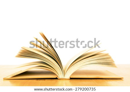 Opened vintage old book on wooden table - stock photo