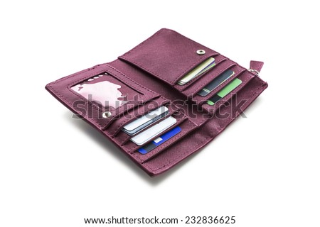 Opened wallet with credit cards on white background