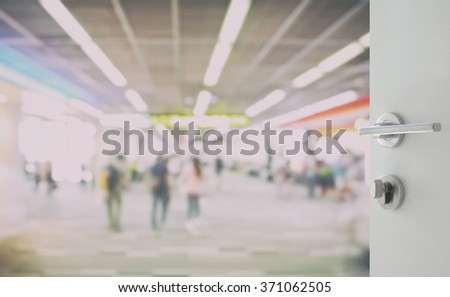 opened white door to walk way at boarding gate in airport - stock photo