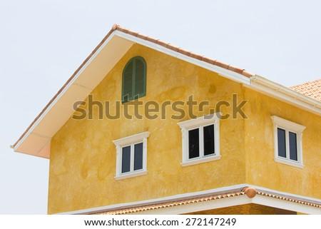 Opened window on yellow wall  - stock photo
