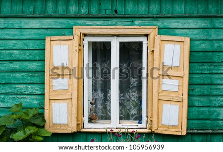 Opened window with decorative colorful shutters - stock photo