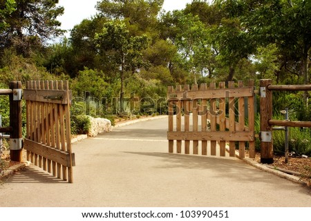 Opened wooden gate - stock photo