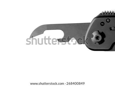 Opener on multitool knife - stock photo