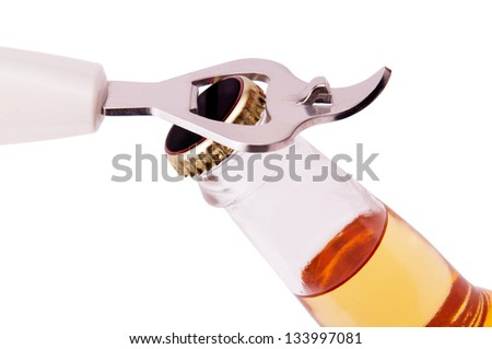 Opening a bottle of beer on a white background - stock photo