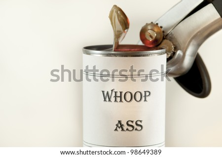 Opening a can of Whoop Ass. - stock photo