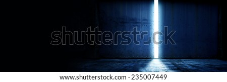 opening a heavy steel door. Large steel doors of an hanger like building opening and light coming in. with plenty of copy space  - stock photo