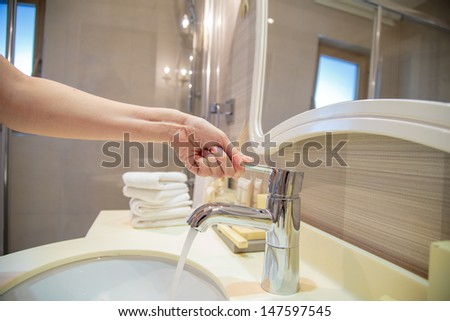 opening a water tap - stock photo