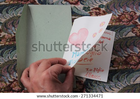 opening a watercolor birthday card - stock photo