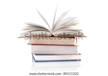 opening book on the stack of books