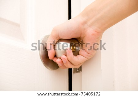 Opening door knob - stock photo