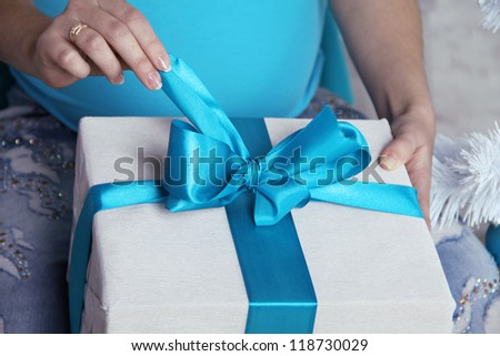 Opening gift boxes with blue bows and ribbons. - stock photo