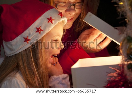 Opening gifts on Christmas and New Year - stock photo