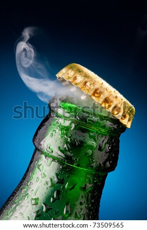 Opening of beer cap with the gas output - stock photo