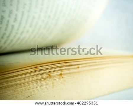 Opening old book. Selective focus. - stock photo