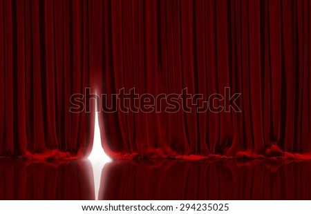 Opening red curtain on theater or cinema stage. - stock photo