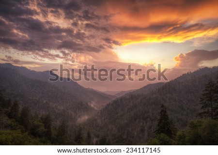 Opening Sky - A storm clearing at sunset creates a dramatic sky at the Morton Overlook in the Great Smoky Mountains National Park. - stock photo
