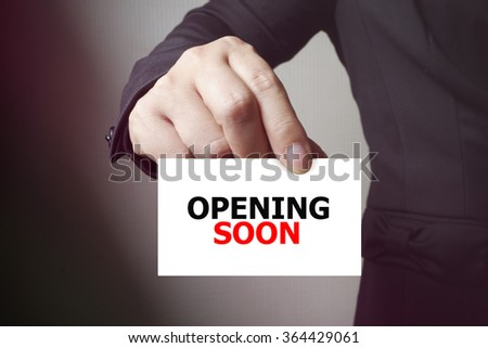 OPENING SOON paper on the card , business concept , business idea