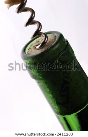 Opening the wine with corkscrew in white background. - stock photo