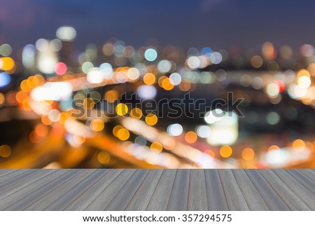 Opening wooden floor, Abstract blurred bokeh city freeway with city background during twilight - stock photo
