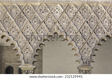 Openwork arches in Alcazar palace, Seville, Spain - stock photo