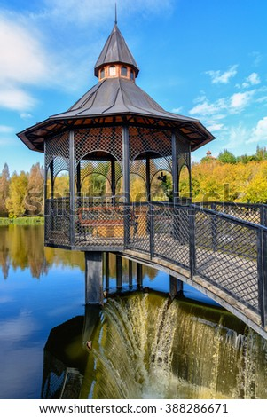 Openwork iron gazebo over the water is
