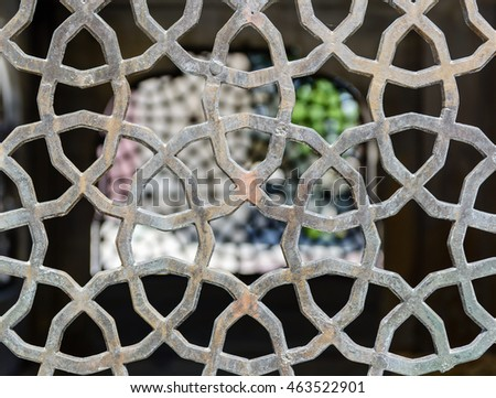 Openwork ventilation grille in oriental style. Detail of the house.
