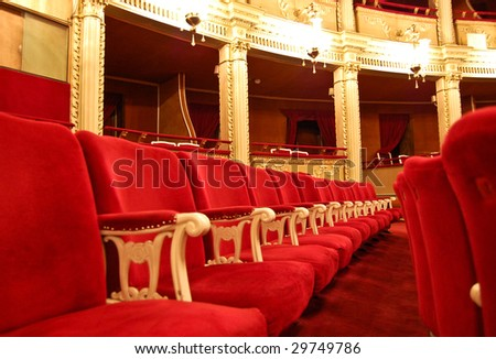Opera House Interior - Seating arrangement, a row of seats with private boxes in the background - stock photo